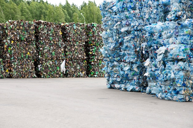A pile of extruded plastic bottles at a garbage collection plant Premium Photo