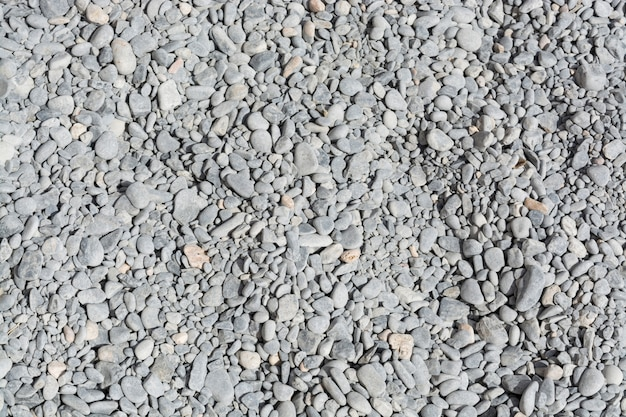 Pile of gray pebbles texture Premium Photo