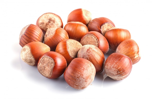 Pile of hazelnuts with shell isolated on white. Premium Photo