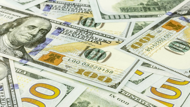 Pile of hundred dollar banknotes Premium Photo