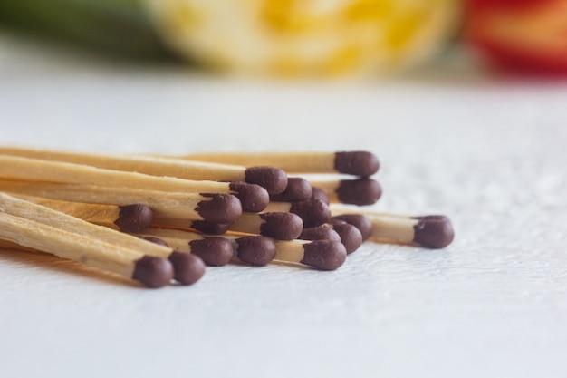 A pile of matches close up on a white table Premium Photo