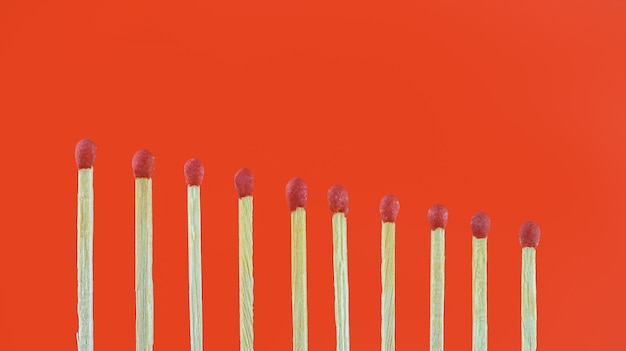 Pile of matchsticks arrange in a row Premium Photo