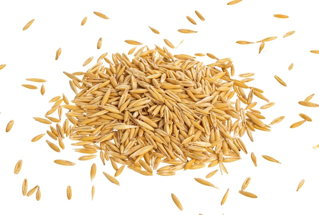 Pile of oat seeds isolated on white, top view Premium Photo