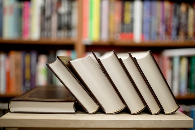 Pile of books lying in library Free Photo