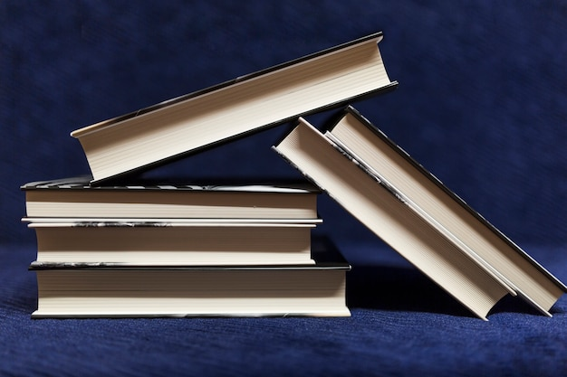 Pile of books on blue background Free Photo