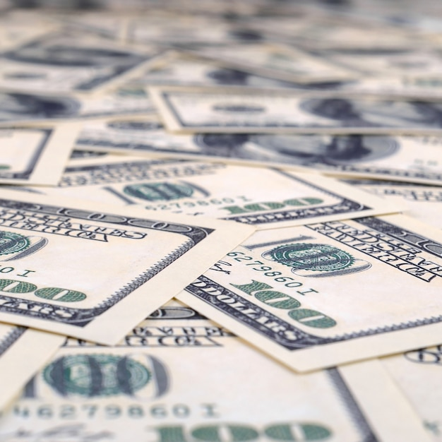Pile of one hundred us banknotes. Premium Photo