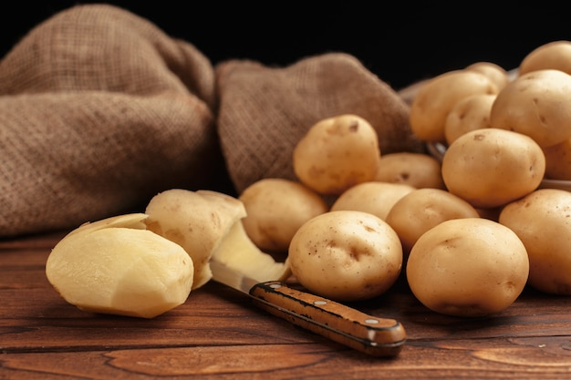 Pile of potatoes lying on wooden boards Premium Photo