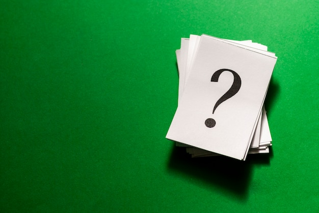 Pile of stacked question marks printed on paper Premium Photo