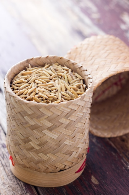 Pile of unmilled paddy grains in bamboo basket Premium Photo