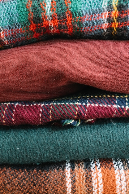 Pile of warm winter sweaters Free Photo