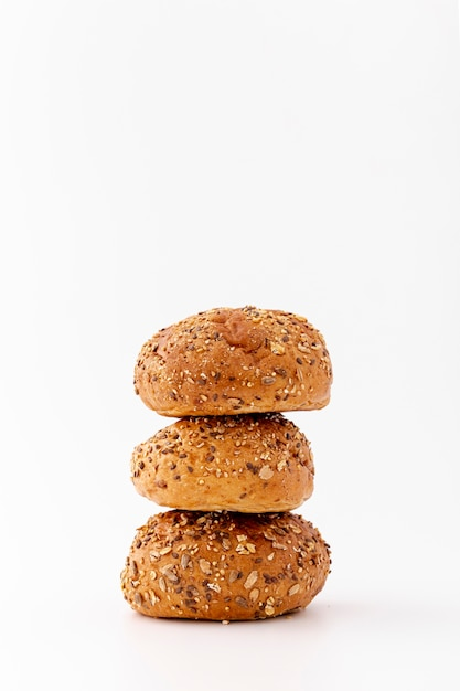 Pile of wholegrain baked buns on white background Free Photo