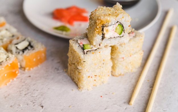 Piled up sushi with seeds Free Photo