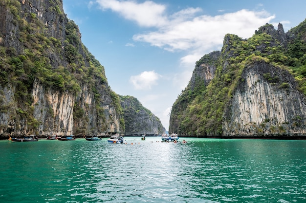 Pileh lagoon limestone mountain surrounded and emerald sea with tourists traveling at krabi Premium Photo