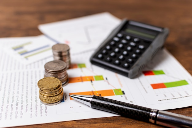 Piles of different coins with stationery decoration Free Photo