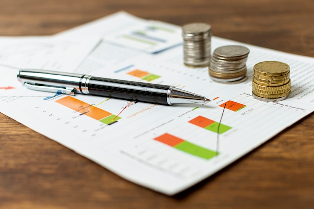 Piles of different coins with stationery elements Premium Photo
