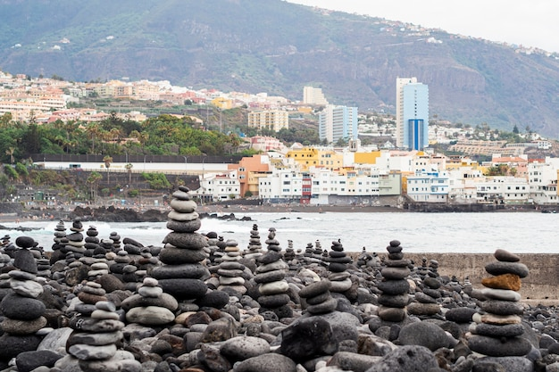 Piles of rocks with city on background Free Photo