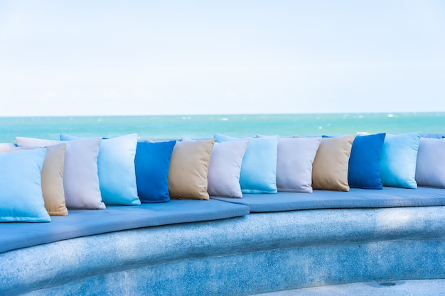 Pillow on chair or sofa lounge around outdoor patio with sea ocean beach view Free Photo