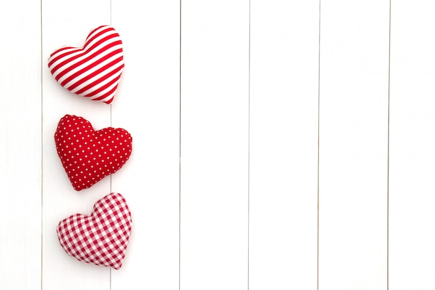 Pillow hearts on white table with copy space. happy valentine's day. Premium Photo
