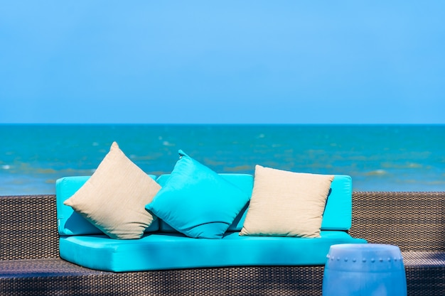 Pillow on sofa furniture decoration neary sea and beach on blue sky Free Photo