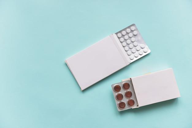 Pills in paper boxes Premium Photo