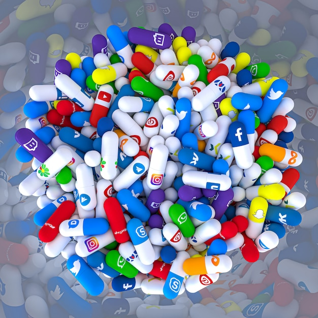 Pills of various types and sizes in a bottle bearing the logo of the most famous social networks Premium Photo