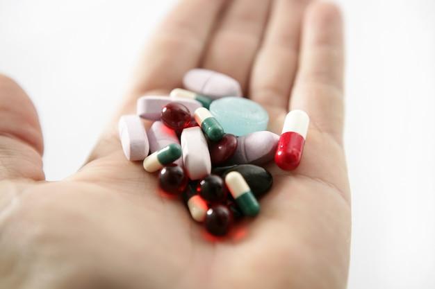Pills over white, health or suicide Premium Photo