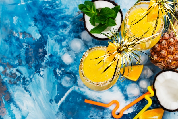 Pina colada cocktail and ingredients Premium Photo
