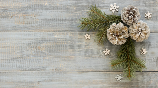 Pine needles on wooden background with conifer cones Premium Photo