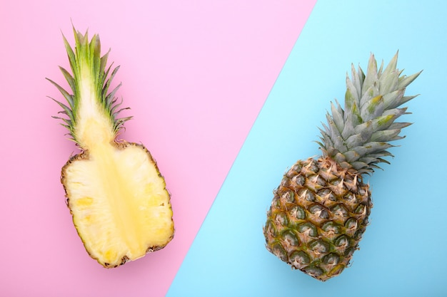 Pineapple and half of pineapple on a colorful background Premium Photo