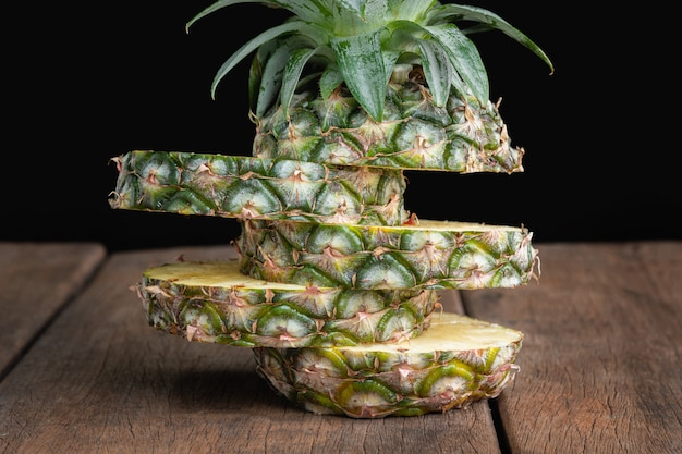 Pineapple on old wooden table Premium Photo
