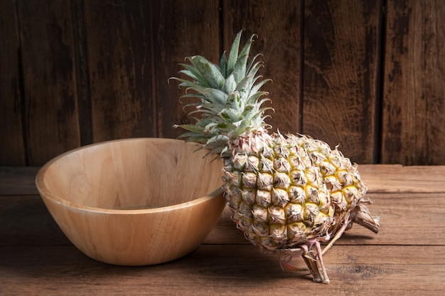 Pineapple And Wooden Tray On A Wooden Table Background Photo