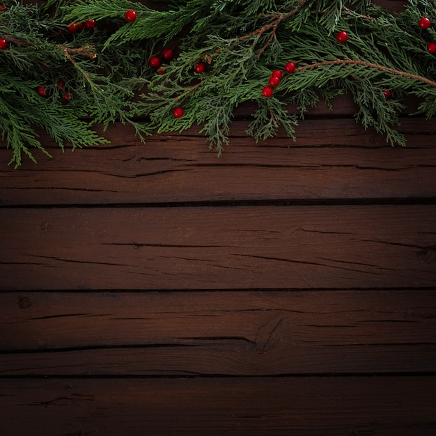 Pines christmas composition on a wooden background with copy space Free Photo