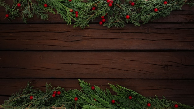 Pines christmas composition on a wooden frame background with copy space Free Photo