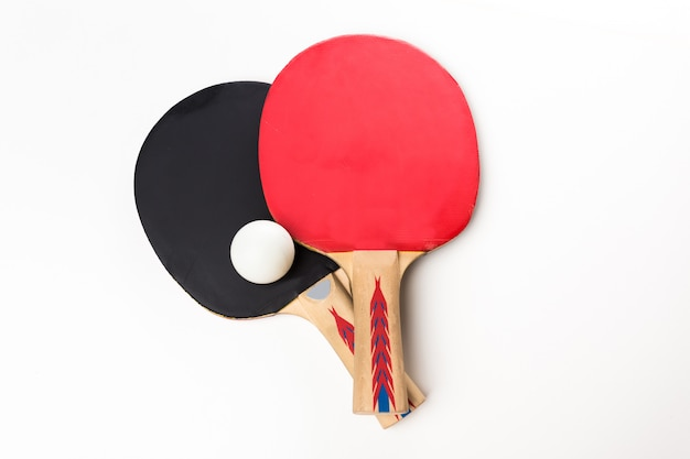 Ping-pong rackets and ball, isolated on white Premium Photo