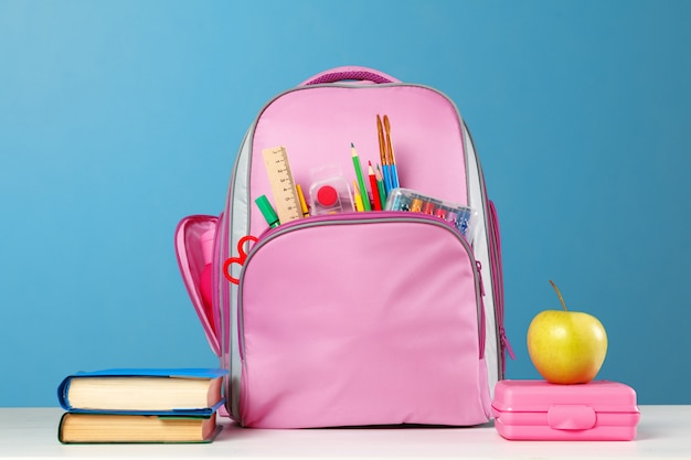 Pink backpack with stationery objects Premium Photo