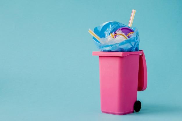 Pink big trash on blue background Premium Photo