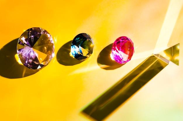 Pink; blue; purple and yellow triangular diamond on yellow background Free Photo