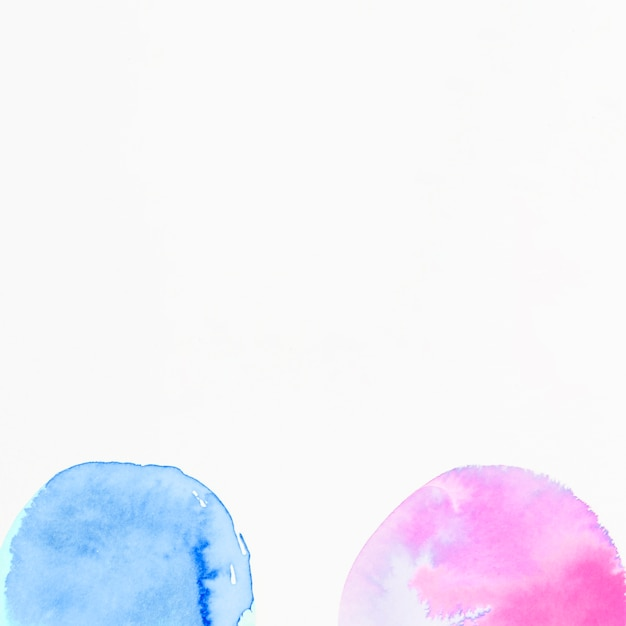 Pink and blue semi circles watercolor on white background Free Photo