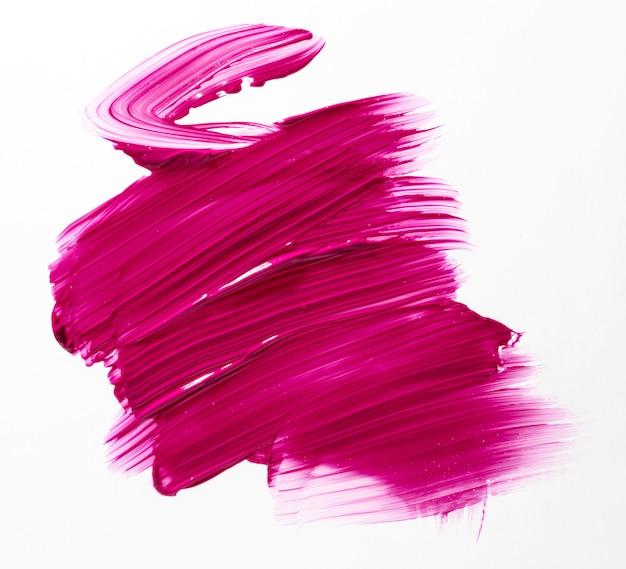 Tratto di pennello rosa con sfondo bianco Foto Gratuite