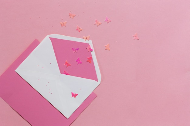 Pink butterflies in the pink envelope on the pink paper Premium Photo