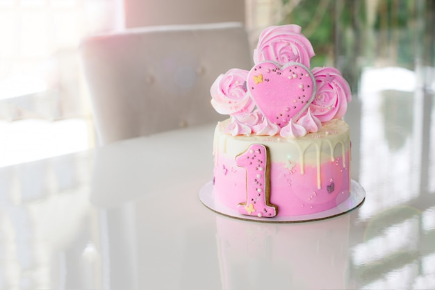 Pink cake at the celebration of the first birthday of the girl Premium Photo