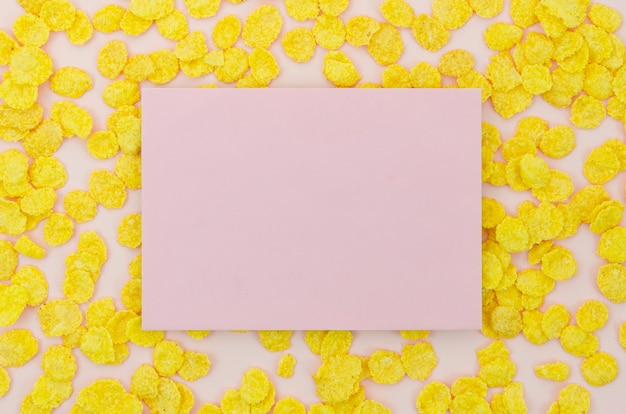 Pink card surrounded by cornflakes Free Photo