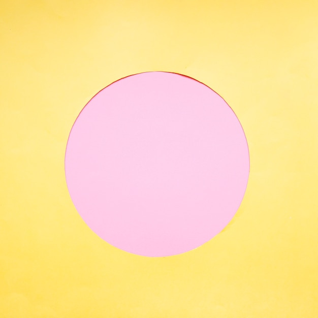 Pink circle on yellow background Free Photo