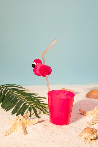 Pink cocktail on sandy beach Free Photo