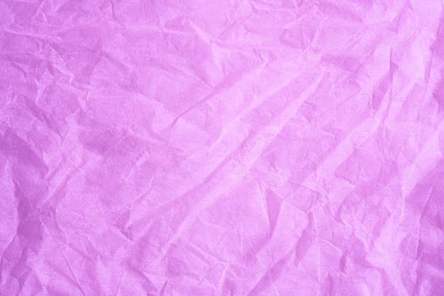 Pink color creased paper tissue background texture. Premium Photo