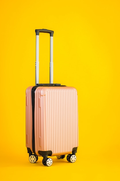 Pink color luggage or baggage bag use for transportation travel Free Photo