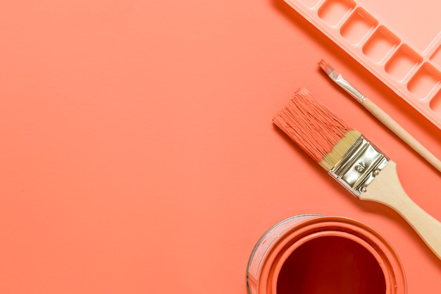 Pink composition with drawing tools on colored surface Free Photo