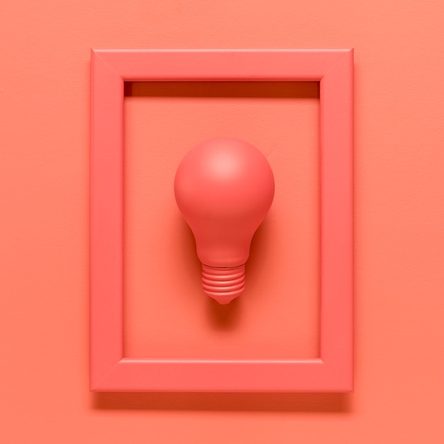 Pink composition with lamp in frame on colored surface Free Photo