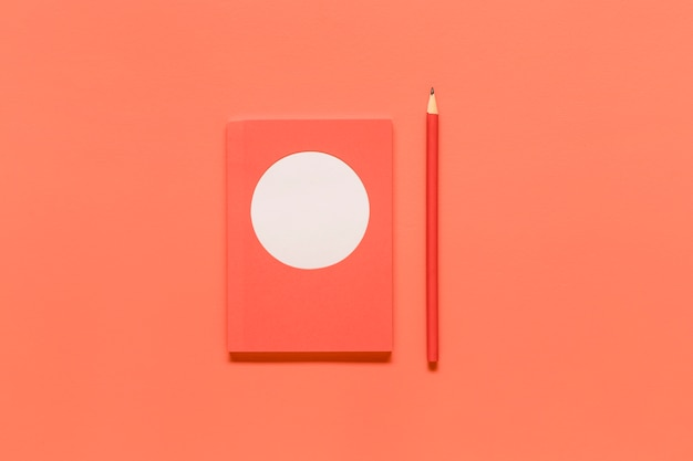 Pink composition with office tools on colored surface Free Photo