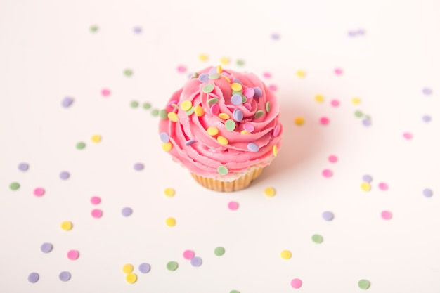 Pink cupcake with lit candle Free Photo